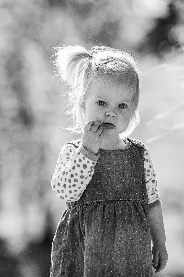 Little girl backlit in the sun