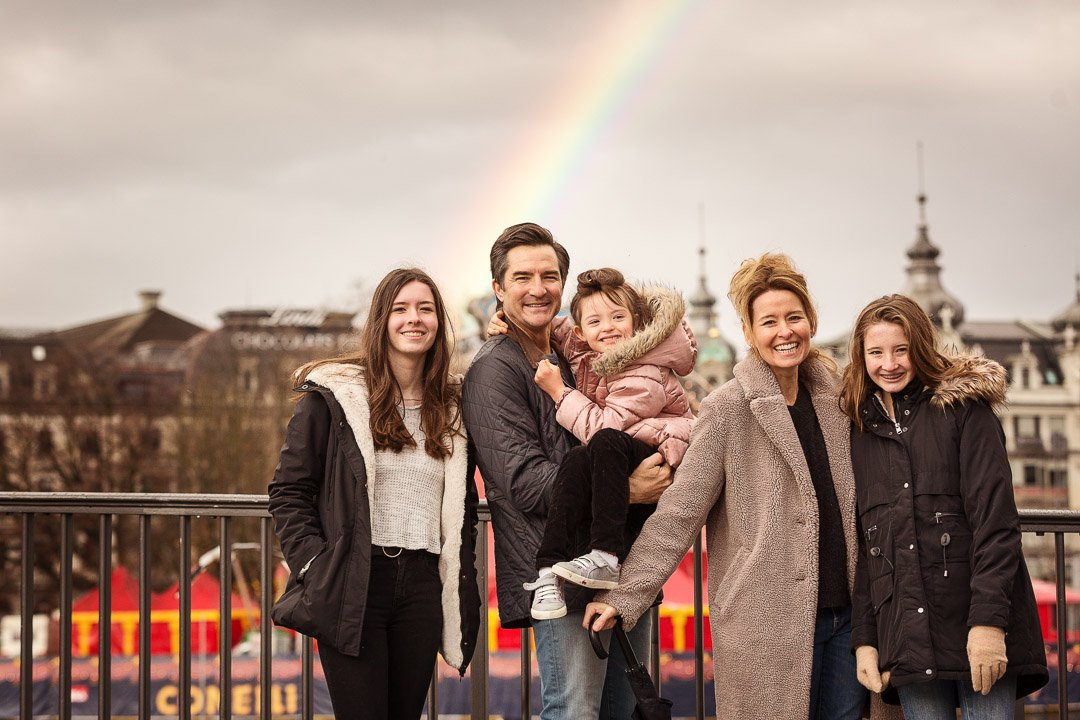Family having a photo shoot with rainbow in Zurich