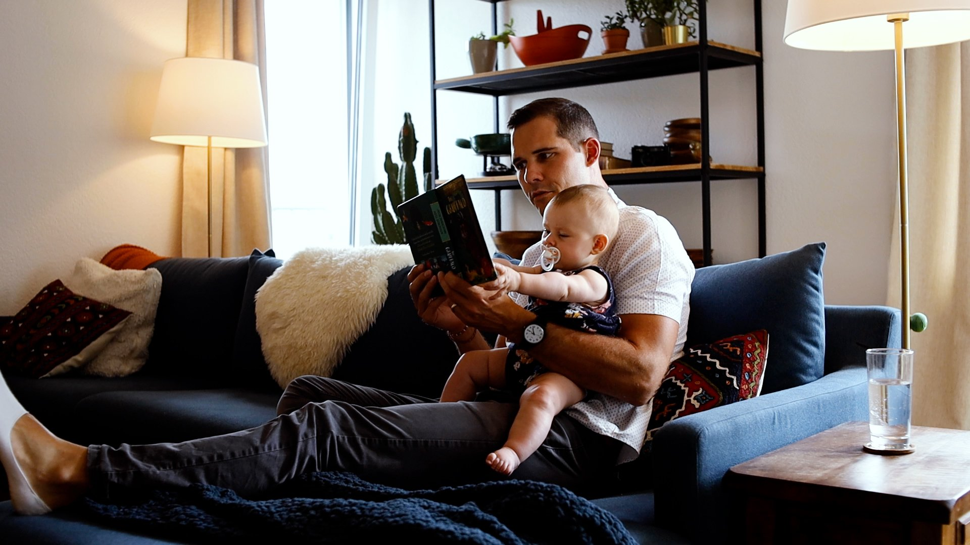 Dad reading to baby daughter