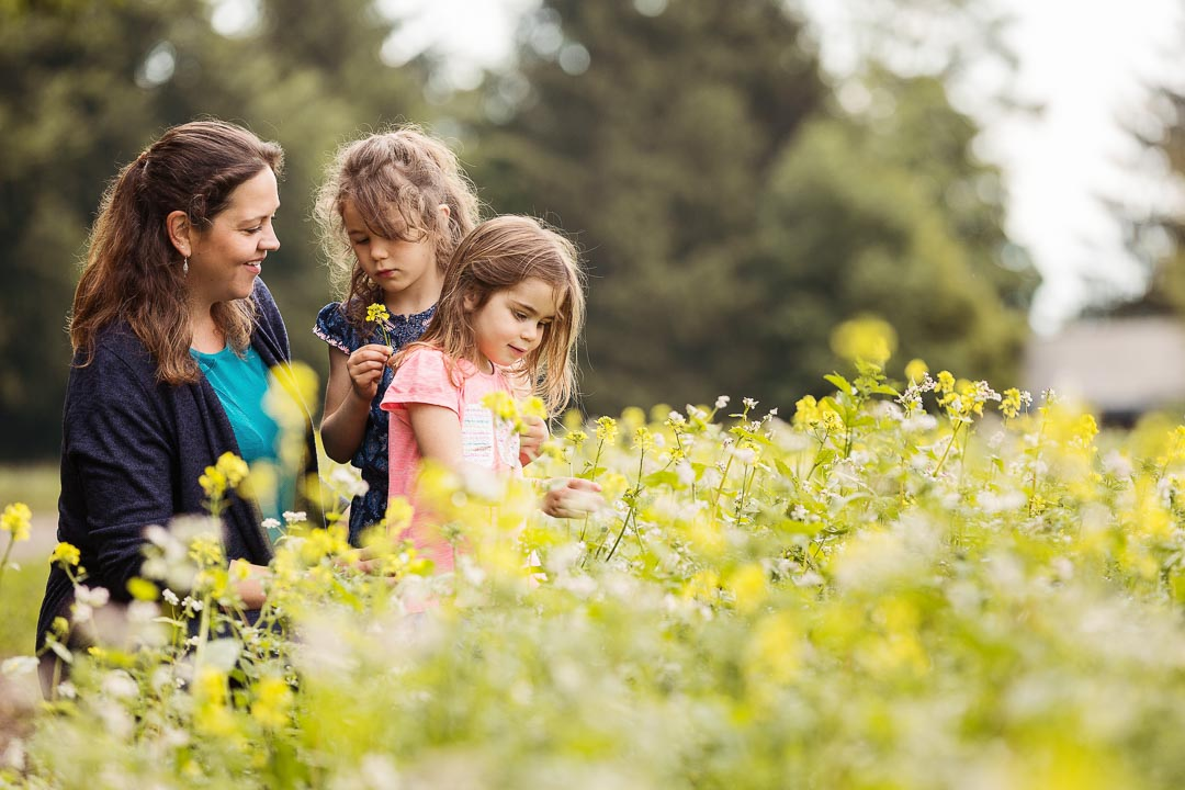Mum with her daughters in a rapeseed field