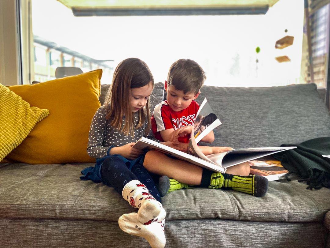 girl and boy reading together