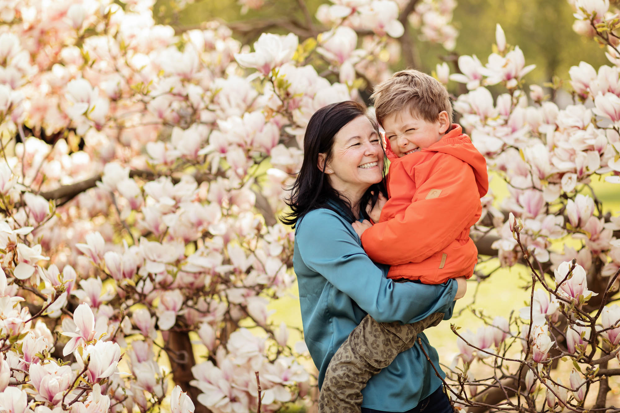 Mum with her son in the magnolias near Landesmuseum Zürich